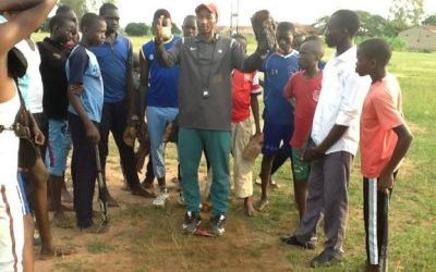 WBSCがウガンダ学校発展プログラムにミニハンドブックを提供